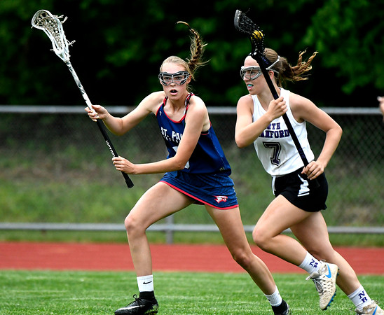 5/31/2018 Mike Orazzi | Staff St. Paul Catholic High School's Addison Davis (8) and North Branford High School's Melanie Norton (7) during the girls Class S Quarterfinals lacrosse at North Branford High School Thursday evening.