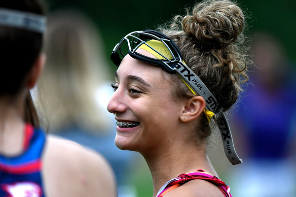 5/31/2018 Mike Orazzi   Staff St. Paul Catholic High School's Christina Pisani (12) during the girls Class S Quarterfinals lacrosse at North Branford High School Thursday evening.