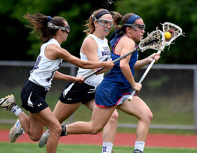 5/31/2018 Mike Orazzi | Staff St. Paul Catholic High School's Catherine Ciampi (2) and North Branford High School's Ali Barrett (14) and Melanie Norton (7) during the girls Class S Quarterfinals lacrosse at North Branford High School Thursday evening.