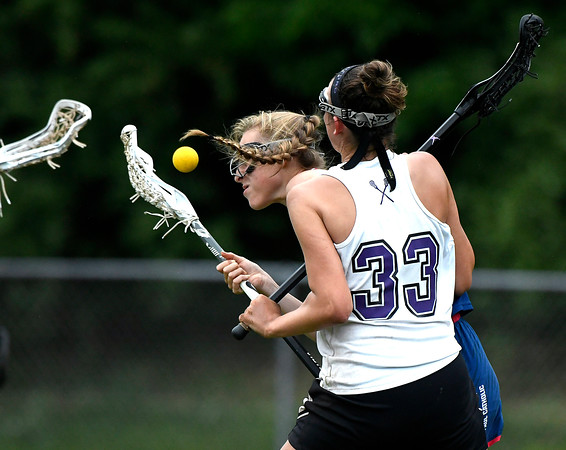 5/31/2018 Mike Orazzi | Staff St. Paul Catholic High School's Addison Davis (8) and North Branford High School's Jessie Kilburn (33) during the girls Class S Quarterfinals lacrosse at North Branford High School Thursday evening.