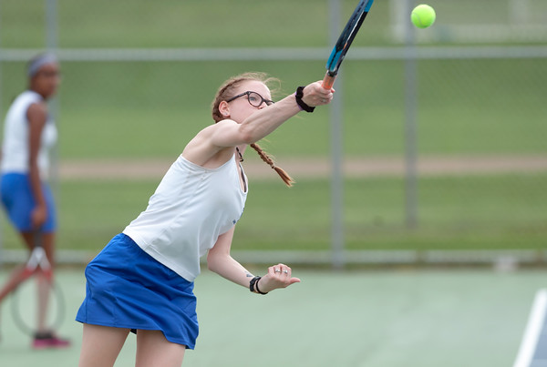 05/03/18 Wesley Bunnell | Staff Bristol Eastern's Julia O'Leary in her match against Newington's Mara Klin on Thursday afternoon at Newington High School.