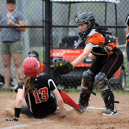 5/3/2018 Mike Orazzi | Staff Terryville's Amy Ieronimo (14) as Wamogo's Cassidy Wilson (13) scores during Thursday's softball game with in Plymouth.