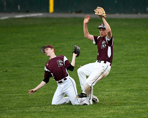 5/2/2018 Mike Orazzi | Staff Bristol Central's Ryan Krompegal (2) and Evan Bouchard (35) during Wednesday's baseball game at Muzzy Field.