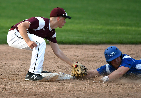 5/2/2018 Mike Orazzi | Staff Bristol Eastern's Matt D'Amato (2) slides safely into second as Bristol Central's Evan Bouchard applies the tag during Wednesday's baseball game at Muzzy Field.
