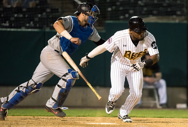 05/04/18 Wesley Bunnell | Staff The New Britain Bees held opening night at New Britain Stadium on Friday night against the Road Warriors. Angelys Nina (7) bunts in the 10th inning.