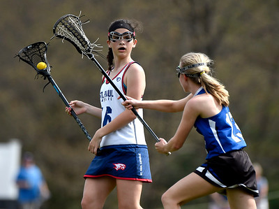 5/4/2018 Mike Orazzi | Staff St. Paul's Greta Panke and Lewis Mills' Maddy Ruby (13) Friday in Bristol.