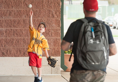 05/04/18  Wesley Bunnell | Staff  Kim Allyn, age 6, plays catch with dad Zach while waiting for the gates to open outside of New Britain Stadium. The New Britain Bees held opening night at New Britain Stadium on Friday night against the Road Warriors.