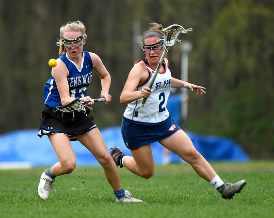 5/4/2018 Mike Orazzi | Staff St. Paul's Catherine Ciampi (2) and Lewis Mills' Maddy Ruby (13) Friday in Bristol.