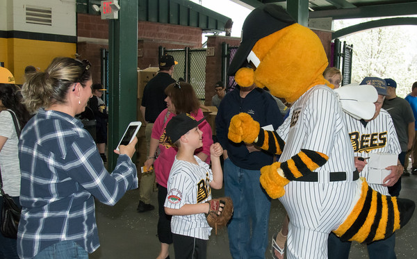 05/04/18 Wesley Bunnell | Staff Curtiss Wentworth, age 8, fist bumps Sting after entering New Britain stadium for the first Bees home game of the 2018 season versus the Road Warriors.