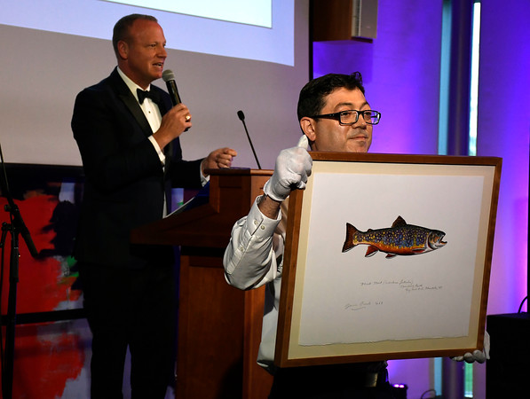 5/5/2018 Mike Orazzi | Staff Scot Haney auctions off the Brook Trout, during the NBMAA 18th annual spring gala and auction, The Art Party of the Year, held Saturday night in New Britain. The piece of art sold for $9500 to bidder 063.