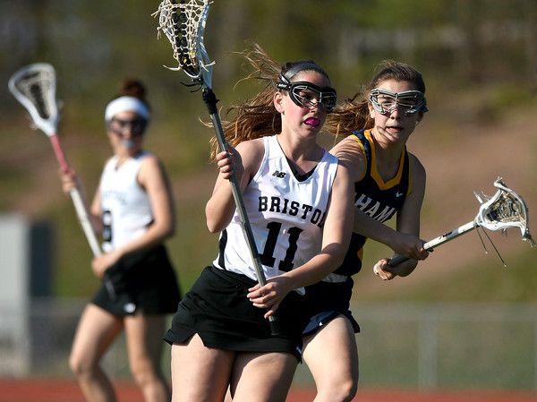 5/8/2018 Mike Orazzi | Staff Bristol Co-Op Lacrosse's Ashley Macdonald (11) and RHAM's Rylee Bane (8) during girls lacrosse at BEHS Tuesday.