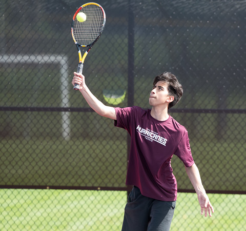 05/08/18 Wesley Bunnell | Staff Berlin boys tennis hosted New Britain on Tuesday afternoon at Berlin High School. New Britain's Saul Rodriguez serves in a doubles match with teammate Jose Garcia against Berlin's Stephen Jendreau and Noah Mihalko.