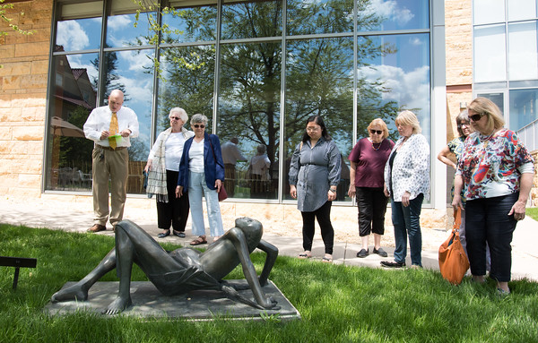 05/08/18 Wesley Bunnell | Staff New Britain Museum of American Art docent Luc Ouellette led a guided tour of the artwork on the grounds of the museum including Walnut Hill Park on Tuesday afternoon. Tour guests stop at the sculpture Prelude (1957) by Marianna Pineda which depicts a pregnant woman in labor.