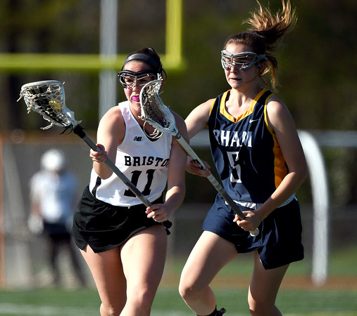 5/8/2018 Mike Orazzi | Staff Bristol Co-Op Lacrosse's Ashley Macdonald (11) and RHAM's Amanda Jacobson (5) during girls lacrosse at BEHS Tuesday.