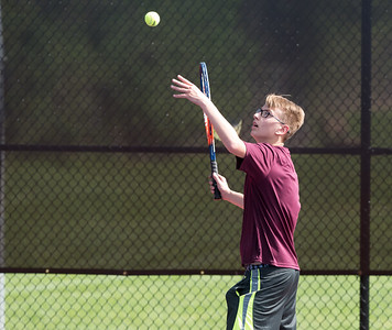 05/08/18  Wesley Bunnell | Staff  Berlin boys tennis hosted New Britain on Tuesday afternoon at Berlin High School. New Britain's Nick Makuch serves in his singles match against Berlin's Ryan Jenkins.