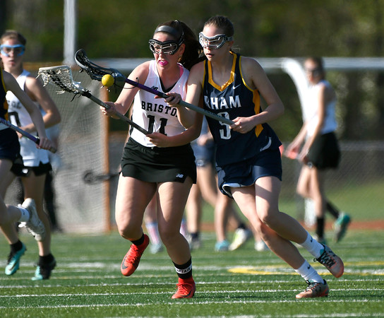 5/8/2018 Mike Orazzi | Staff Bristol Co-Op Lacrosse's Ashley Macdonald (11) and RHAM's Paige Tarallo (9) during girls lacrosse at BEHS Tuesday.