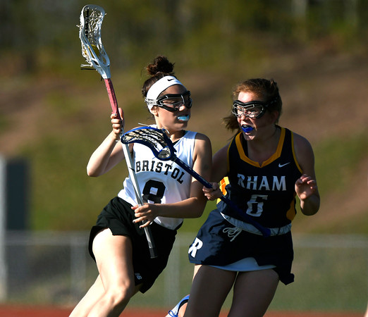 5/8/2018 Mike Orazzi | Staff Bristol Co-Op lacrosse's Gabby Abramczyk (8) and RHAM's Amanda Acabchuk (6) during girls lacrosse at BEHS Tuesday.