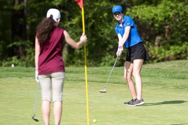 05/09/18 Wesley Bunnell | Staff Berlin girls golf vs New Britain on Wednesday afternoon at Timberlin Golf Course in Berlin. Berlin's Bridget McQuillan with a long putt.