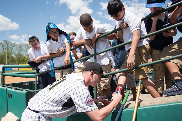 05/09/18 Wesley Bunnell | Staff The New Britain Bees held a special day game with a packed crowd of area school children for their game versus the Long Island Ducks. Mike Hepple (21) signs Pulaski School 6th grader Alex Rosales.