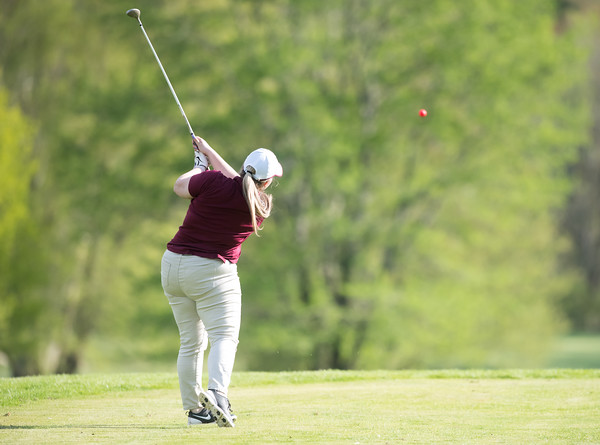 05/09/18 Wesley Bunnell | Staff Berlin girls golf vs New Britain on Wednesday afternoon at Timberlin Golf Course in Berlin. New Britain's Kendra Levesque with a tee shot.