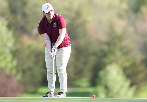 05/09/18 Wesley Bunnell | Staff Berlin girls golf vs New Britain on Wednesday afternoon at Timberlin Golf Course in Berlin. New Britain's Kendra Levesque with her putt.