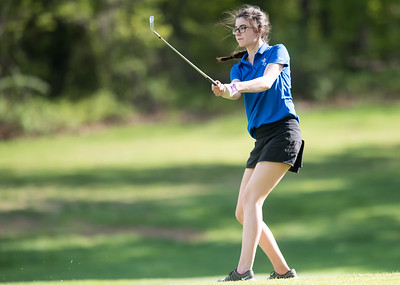 05/09/18  Wesley Bunnell | Staff  Berlin girls golf vs New Britain on Wednesday afternoon at Timberlin Golf Course in Berlin. Berlin's Bridget McQuillan with a short iron onto the green.