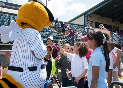 05/09/18  Wesley Bunnell | Staff  The New Britain Bees held a special day game with a packed crowd of area school children for their game versus the Long Island Ducks.  Third grader Rorbelis Cruz high fives Sting.
