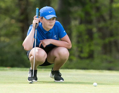 05/09/18  Wesley Bunnell | Staff  Berlin girls golf vs New Britain on Wednesday afternoon at Timberlin Golf Course in Berlin. Berlin's Jess Nappi lines up her putt.