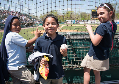 05/09/18  Wesley Bunnell | Staff  The New Britain Bees held a special day game with a packed crowd of area school children for their game versus the Long Island Ducks.  A third grader from Smalley smiles after being handed a baseball by Deibinson Romero (24).
