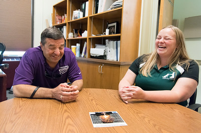 06/05/18  Wesley Bunnell | Staff  Newington Superintendent of Parks and Recreation Bill DeMaio enjoys a laugh with daughter Laura DeMaio Roy as they discuss the training that was involved with Izaac, a service dog, who assists Bill DeMaio, who is blind, in his daily activities. Laura DeMaio Roy runs LEDR Dog Training and personally picked and trained Izaac for her father.