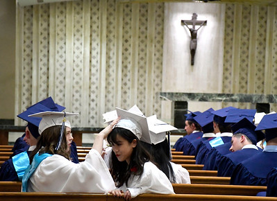 """6/5/2018 Mike Orazzi   Staff St. Paul Catholic High School graduates Molly Hooks and Xuege """"Doris"""" Zhang during Tuesday evening's commencement ceremony at the Cathedral of Saint Joseph in Hartford."""