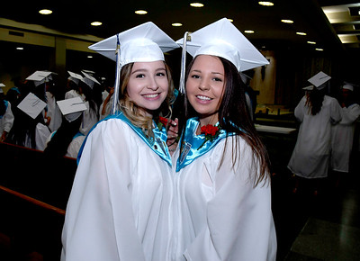 6/5/2018 Mike Orazzi | Staff St. Paul Catholic High School graduates Bella Hamelin and Brooke Mazzarelli during Tuesday evening's commencement ceremony at the Cathedral of Saint Joseph in Hartford.