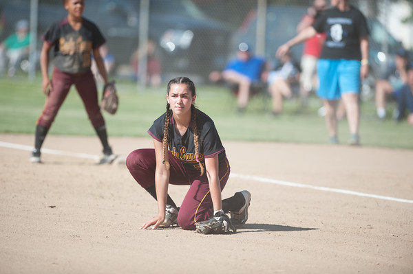 05/30/18 Wesley Bunnell | Staff Southington softball defeated New Britain 19-1 in a second round Class LL tournament game at Southington on Wednesday afternoon. Valentina Hernandez (7) kneels as she watches a play unfold down the third base line.