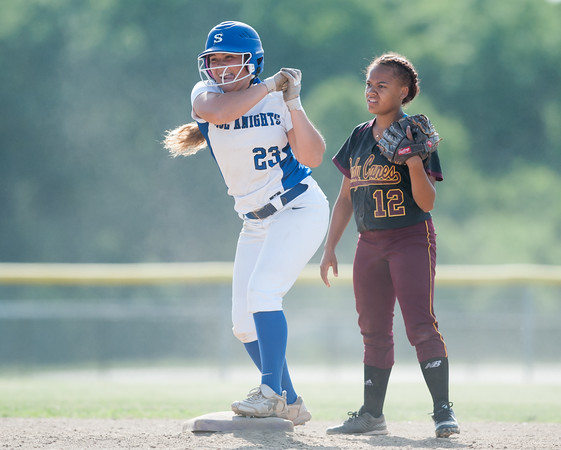 05/30/18 Wesley Bunnell | Staff Southington softball defeated New Britain 19-1 in a second round Class LL tournament game at Southington on Wednesday afternoon. Madison Rocha (23) motions back to teammates after hitting a double.