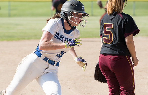 05/30/18 Wesley Bunnell | Staff Southington softball defeated New Britain 19-1 in a second round Class LL tournament game at Southington on Wednesday afternoon. Sarah Myrick (19) rounds third base on her way home.