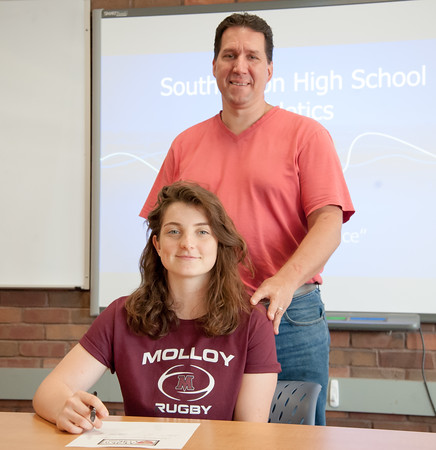 05/30/18 Wesley Bunnell | Staff Southington rugby player Kaitlyn Demaio poses for a photo with her father Mark Demaio before she signs her letter of intent on Wednesday afternoon to attend and play for Molloy College.