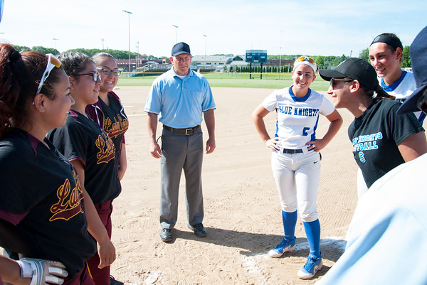 05/30/18 Wesley Bunnell | Staff Southington softball defeated New Britain 19-1 in a second round Class LL tournament game at Southington on Wednesday afternoon. Coaches and captains for both teams meet before the start of the game.