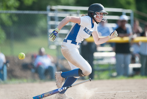 05/30/18 Wesley Bunnell | Staff Southington softball defeated New Britain 19-1 in a second round Class LL tournament game at Southington on Wednesday afternoon. Sarah Myrick (19) bunts for a base hit.