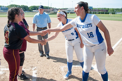 05/30/18  Wesley Bunnell | Staff  Southington softball defeated New Britain 19-1 in a second round Class LL tournament game at Southington on Wednesday afternoon. Coaches and captains for both teams meet before the start of the game Gianna Gonzales (4) shakes hands with Frankie Ferrante (5) and Gabby Roy shakes hands with Kara Zazzaro (18).