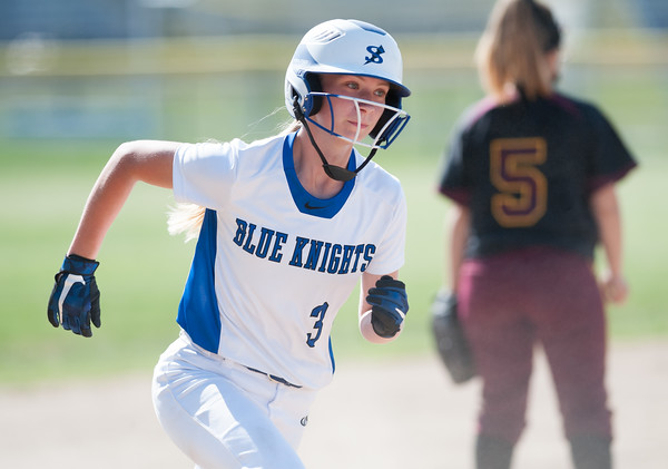 05/30/18 Wesley Bunnell | Staff Southington softball defeated New Britain 19-1 in a second round Class LL tournament game at Southington on Wednesday afternoon. Kristin Rose (3) rounds third base on her way home.