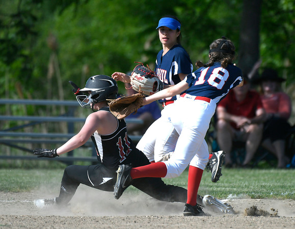 5/30/2018 Mike Orazzi | Staff St. Paul Catholic High School's Caleigh Mcdougall (18) and Somers' Kendall McNamee (11) during Wednesday's Class S Second Round Softball game in Bristol.