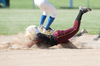 05/30/18  Wesley Bunnell | Staff  Southington softball defeated New Britain 19-1 in a second round Class LL tournament game at Southington on Wednesday afternoon. Nana Andujar (12) slides safely head first into second base