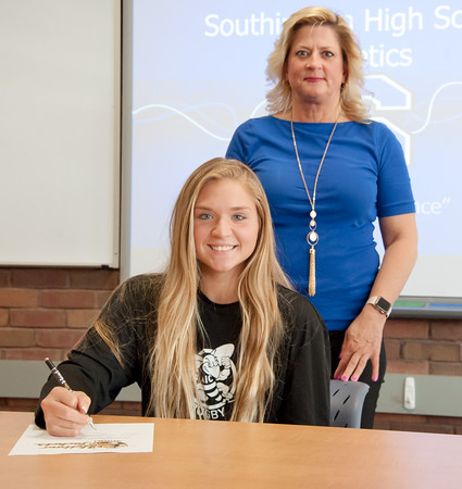 05/30/18 Wesley Bunnell | Staff Southington rugby player Brooke Garcia poses for a photo with her mother Karen Gauvin before she signs her letter of intent on Wednesday afternoon to attend and play for American International University.