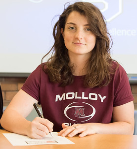 05/30/18  Wesley Bunnell | Staff  Southington rugby player Kaitlyn Demaio signs her letter of intent on Wednesday afternoon to attend and play for Molloy College.