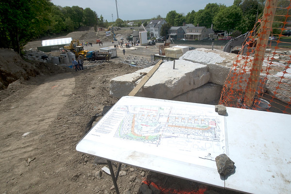 JIM VAIKNORAS/Staff photo Plans on display, and a overall view at the ground breaking of Hillside Center for Sustainable Living in Newburyport Friday.