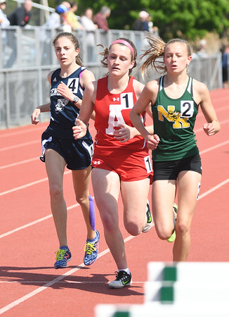 JIM VAIKNORAS/Staff photo From the left: Hamilton-Wenham's Rebecca Erhard, Amesbury's Michaela Halloran, and North Reading's Lindsay McLellan run the 2 mile in the Cape Ann League Track and Field championships at Mascomonet in Boxford Saturday.