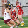 BRYAN EATON/Staff photo. Newburyport's Molly Rose Kearney runs into Masconomet defenders Robyn Seymour and Tara Gallagher.