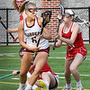 BRYAN EATON/Staff photo. Newburyport's Molly Rose Kearney looks to move past Sarah Reblin.