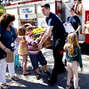 BRYAN EATON/Staff photo. First-graders from the Dr. John C. Page Elementary School in West Newbury and the town's first responders teamed up to collect much-needed goods for the town's food pantry supporting local families in need. Wednesday morning the students and safety personnel unloaded two fire engines at the senior center with the collected goods.