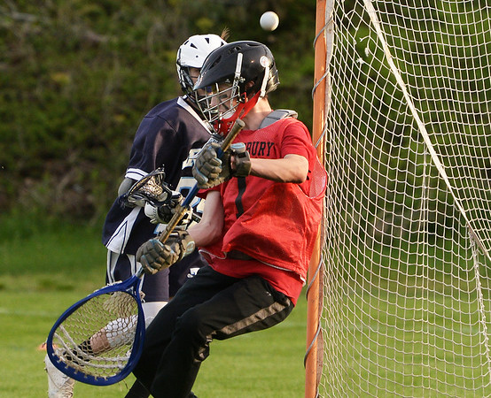 CARL RUSSO/Staff photo. Amesbury's goalie and senior player, Carter Castay makes the save. This year Amesbury High School sponsored boys lacrosse for the first time, and the program competed at the JV level for its inaugural season. Monday night the program celebrated its first ever senior night, honoring it only senior, Carter Castay and his family. 5/14/2018